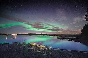 Winterliches Finnland unter dem Polarlicht